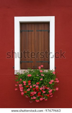 Window of one of the colored houses in Burano - Venice - Italy - stock photo