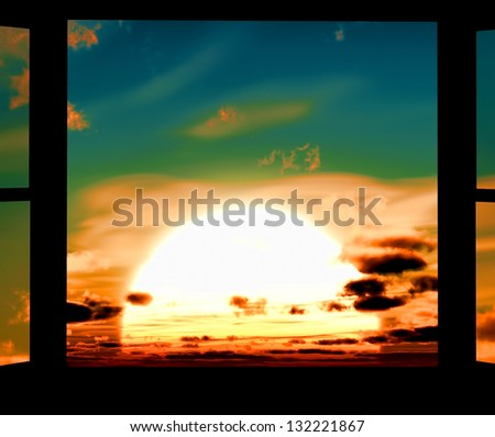 Window of opportunity  overlooking  dramatic sky and huge sun - stock photo