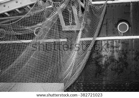 Window of the ship and hanging down networks, close up - stock photo