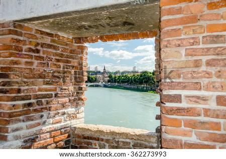Window on Castelvecchio Bridge with view over Adige River in Verona, Italy - stock photo