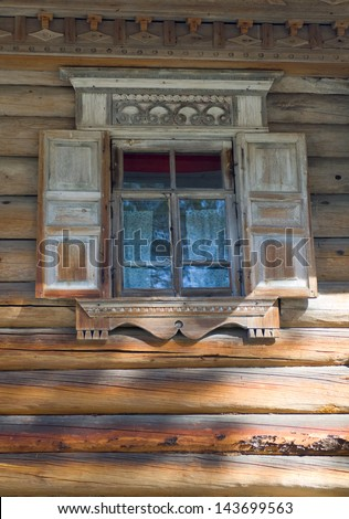 Window on old wooden house in Malye Karely (Little Karely) near Arkhangelsk, north of Russia, Europe - stock photo