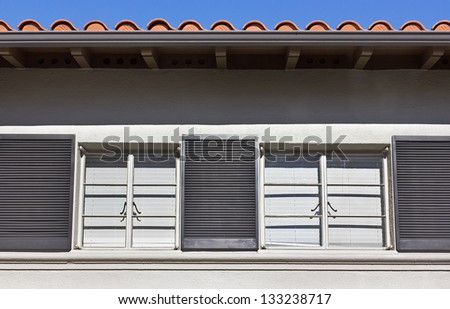 Window on the outside of a home. - stock photo