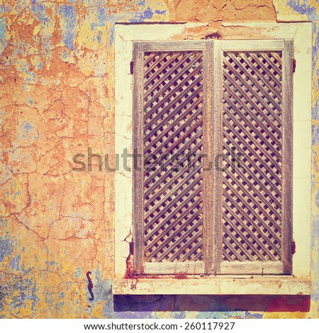 Window on the Peeling Facade of the Old Portugal House, Instagram Effect - stock photo
