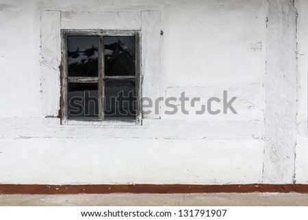 window on the village wall - stock photo