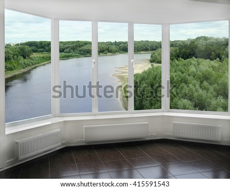 window overlooking the beautiful landscape with Desna river and green willows - stock photo