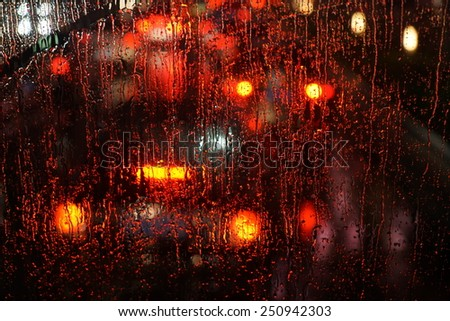 window rain blurred city lights - stock photo