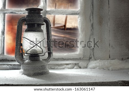window sill and oil lamp  - stock photo