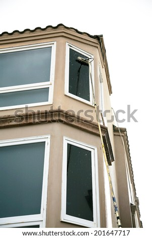 Window Washing with Deionized water and extension pole. For a Spot Free Wash and Rinse!  - stock photo