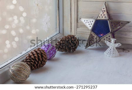 Window winter decoration Christmas decoration on the eve of Advent - stock photo