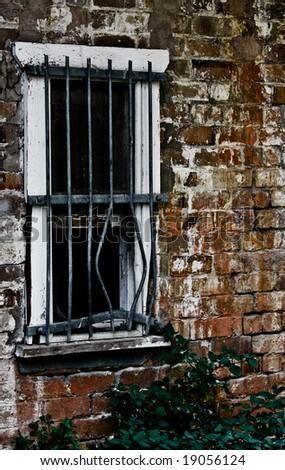 window with bent bars - stock photo