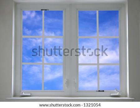 window with blue sky - stock photo