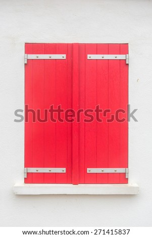 Window with colorful shutters on the opal coast in northern France - stock photo