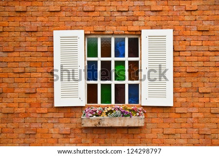 Window with flower pots. - stock photo