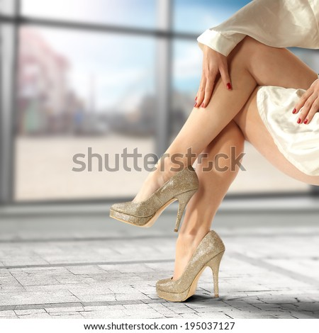 window with glass and legs  - stock photo