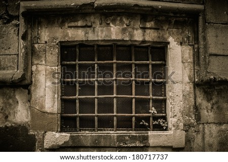 Window with lattice in old building - stock photo