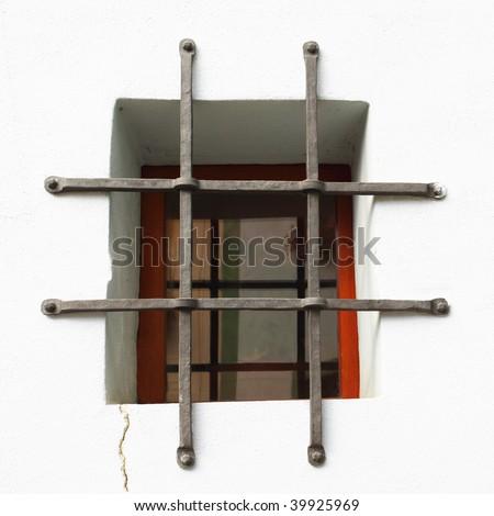Window with metal bars - stock photo