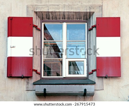 window with red and white shutters in old house, Innsbruck, Austria - stock photo