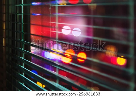 window with the background of the night city - stock photo