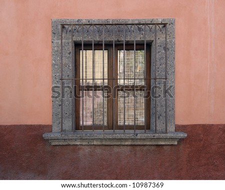Window with wrought iron grill in San Miguel de Allende, Mexico - stock photo