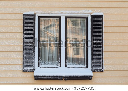 Windows and shutters from an older heritage home. - stock photo