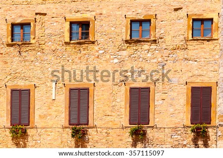 windows and windowframes on a brick building in tuscany, italy - stock photo