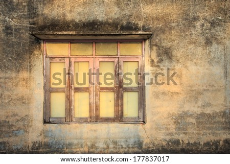 Windows frame on the old cement wall  - stock photo