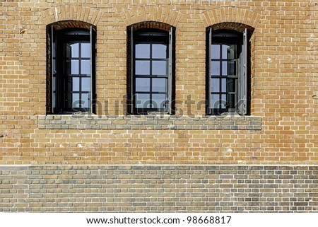 Windows in a red brick wall (at Yokohama Red Brick Warehouse) - stock photo