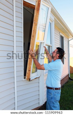 Windows in older home have wood frames, the wood is rotting, new vinyl e-glass windows will be installed - stock photo