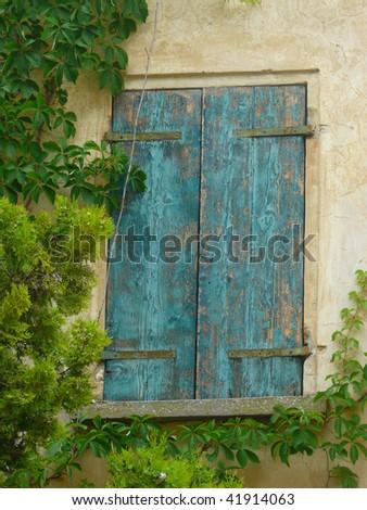 Windows of the old farmhouse - stock photo