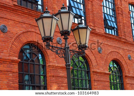 windows on old building of historic Poznanski factory in restored shopping centre-Manufactura in Lodz (Poland) - stock photo