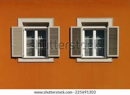 windows with shutters - stock photo