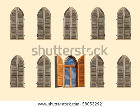 Windows with shutters on an old house - stock photo
