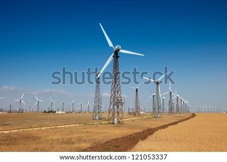 windpower generator on blue sky - stock photo