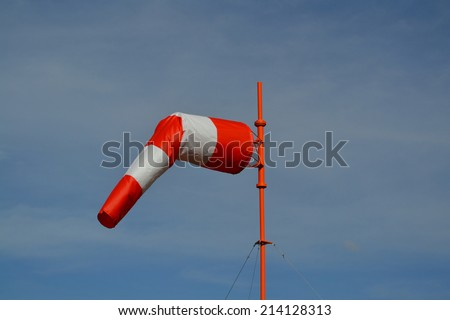 Windsock in calm overcast weather  - stock photo