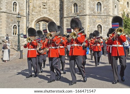 WINDSOR, ENGLAND - AUGUST 28: Royal Guards come out of Windsor Castle, one of the official residences of the British Royal Family in August 28, 2012 - stock photo