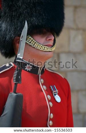 WINDSOR, ENGLAND - CIRCA 2008: Close-up of guard at Windsor Castle - stock photo