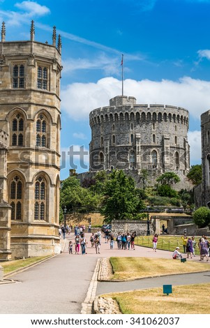 Windsor, England - JUNE 24 : Windsor Castle pictured on June 24, 2015 in Windsor, England. It was built in 1066 by William the Conqueror and it is the longest occupied palace in Europe.  - stock photo