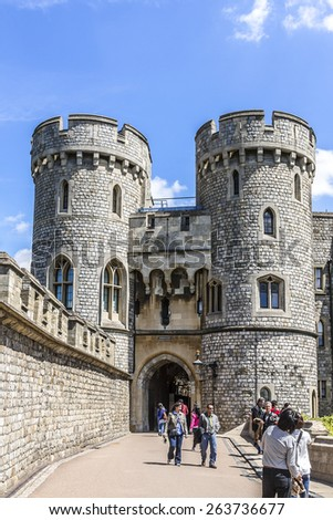 WINDSOR, ENGLAND - MAY 27, 2013: View of Medieval Windsor Castle. Windsor Castle is a royal residence at Windsor in the English county of Berkshire. - stock photo