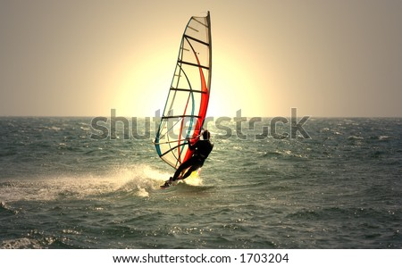 windsurfer and sunset - stock photo