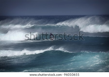 Windsurfer in big waves on Maui - stock photo