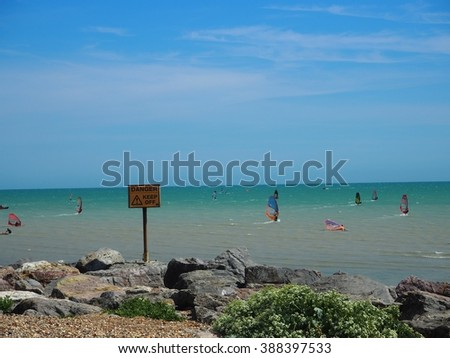 Windsurfers in Lancing on a summer day in May - stock photo