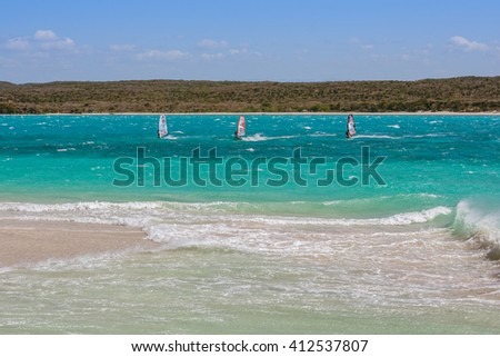 Windsurfers playing in the waves - stock photo