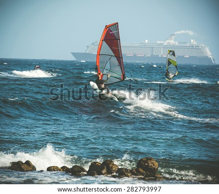 windsurfing and liner on backgroung - stock photo
