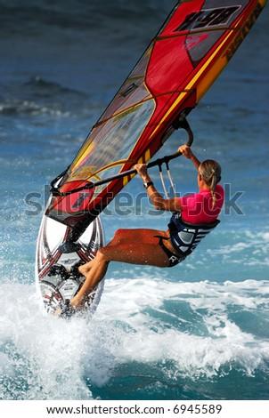 Windsurfing at Hookipa Beach Park Maui Hawaii - stock photo