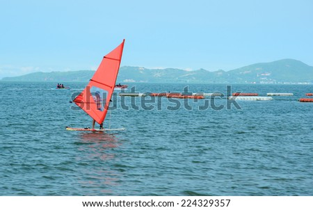 Windsurfing in the ocean - stock photo
