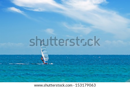 windsurfing on a clear day - stock photo