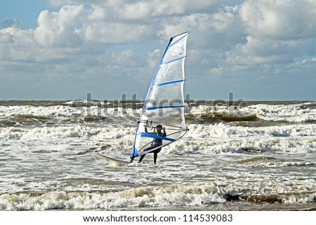 Windsurfing on the north sea in the Netherlands - stock photo