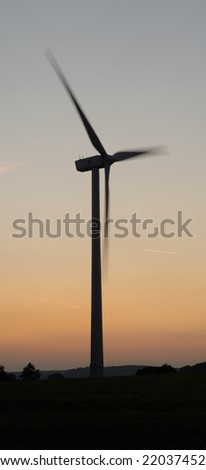 windturbine rotating on sunset - Europe - stock photo