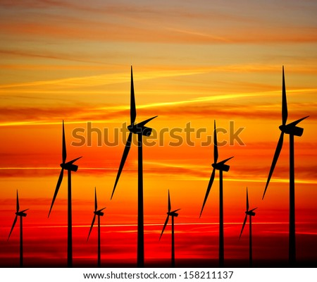 Windturbines at sunset - stock photo