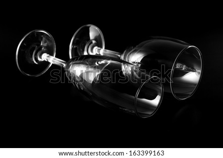 wine and champagn glass laying on black background - stock photo